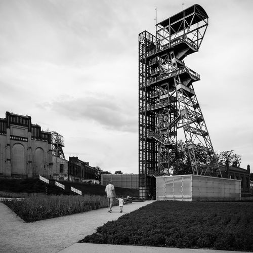 Hoist tower of pit shaft located in the former Katowice coal mine. 2017 - #02. Eye4photography  EyeEm Selects EyeEm Best Shots Architectural Detail Black And White Silesia Real People Tourist Destination Low Angle View Industrial Steel Structure  Tower Industrial Building  Building Exterior Built Structure Architecture