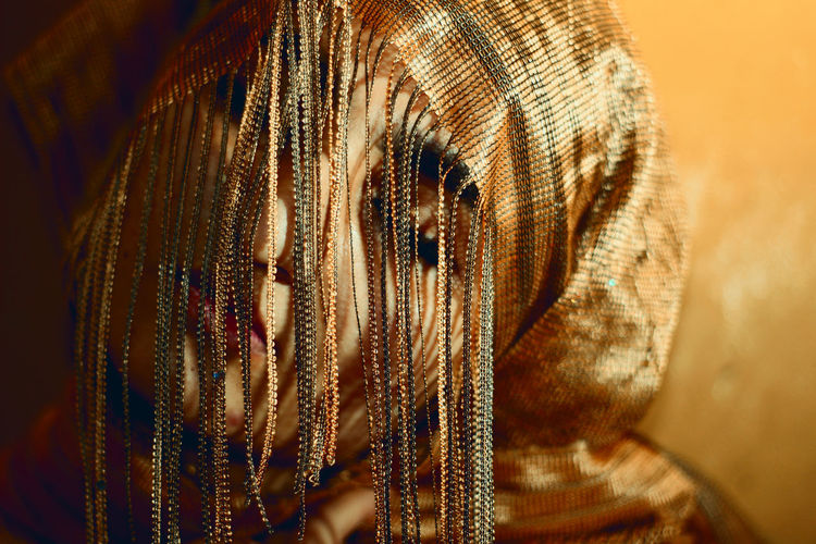Close-up of woman with headwear