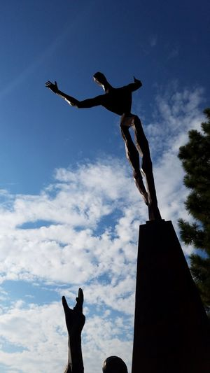 Veteran Memorial Sculpture Low Angle View Silhouette Hand Reaching Reaching Honor Sky Rural Landscape Mindful Service To Country Country Memories Remembering Caring Dramatic Serviceman Servicewomen Quality Of Life Weed, CA Surreal Painful Outdoors Low Angle View Honoring The Fallen