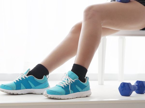 Woman leg with sport shoes and weight training. Diet Close-up Day Exercising Human Body Part Human Leg Indoors  Leisure Activity Lifestyles Low Section Real People Sport Sport Woman Two People Weight White Background Young Adult Young Women