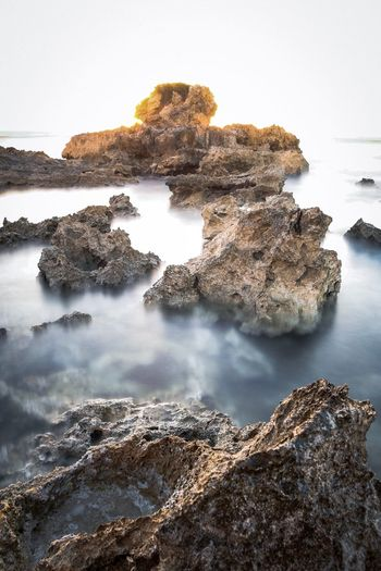 Lava Rock Water No People Nature Beauty In Nature Rock Tranquility Sky Outdoors Sunlight Waterfront Shallow Sea EyeEmNewHere