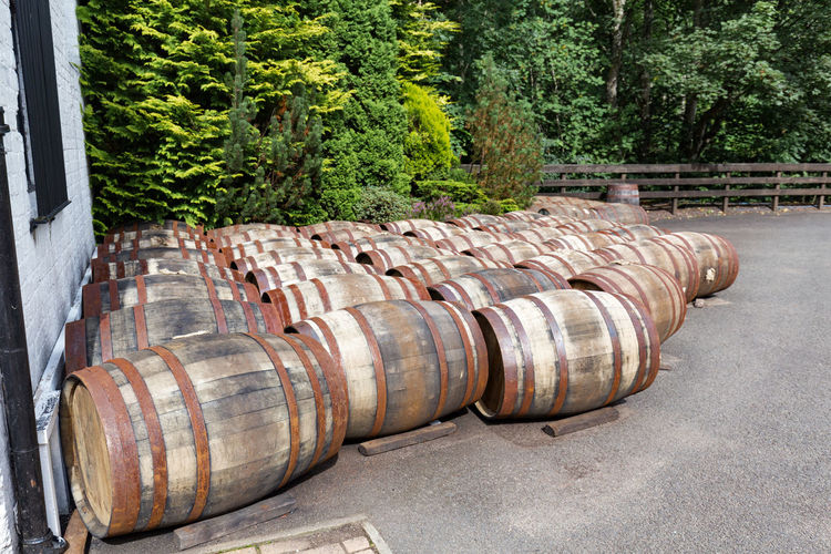 Barrels at a distillery in Scotland. Crieff Distillery Tour Famous Industry Perthshire Rural Scotland Scottish Tourist Travel United Kingdom Alcohol Barrels Distillery Experience Famous Grouse Glenturret Highlands Malt Outdoors Scotch Spirits Tour Tourism Whiskey