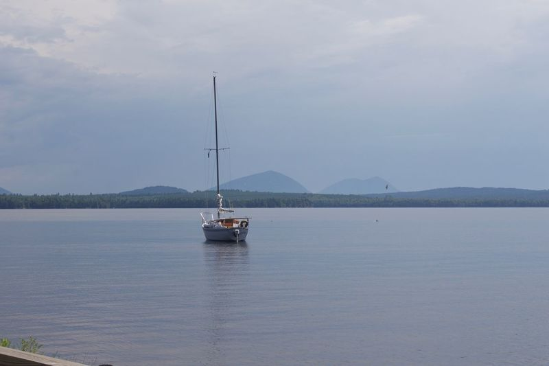 Calm Calm Water Clear Water Freshwater Lake Maine Mainethewaylifeshouldbe Mountain View Sailboat Tranquil Scene Tranquility