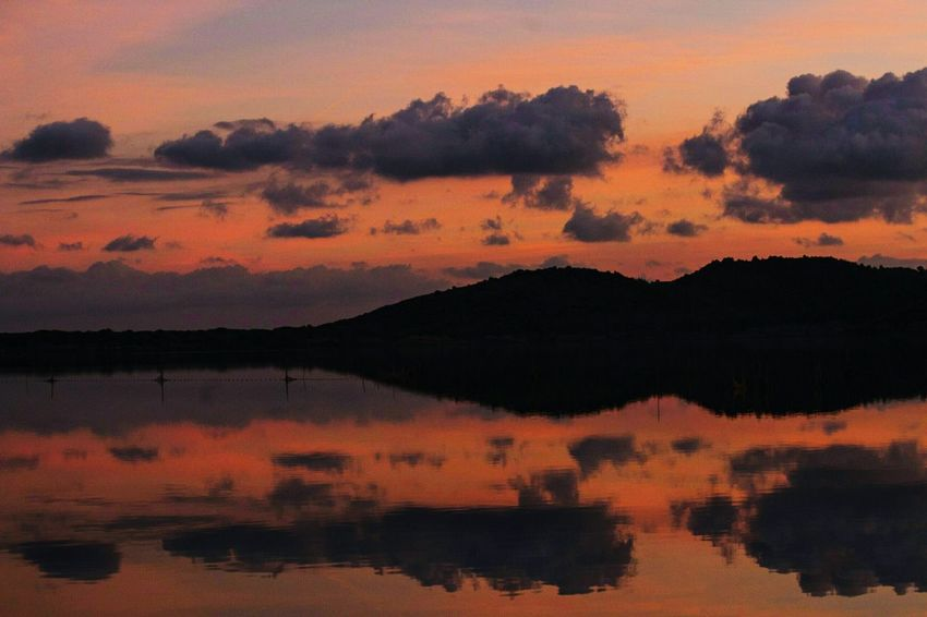 Sunset Dramatic Sky Scenics Reflection Outdoors Silhouette Multi Colored Travel Destinations Travel Photography Landscape Beauty In Nature Mountain Nature No People Sky Red Tranquility Nature Photography Nature Lovers Eye4photography  Architecture Water Art Alone Horizon Over Water