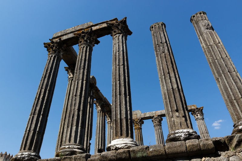 Low angle view of roman temple of evora against sky