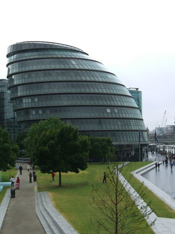 City Hall Architecture Building Exterior Built Structure Capital City City Hall Cityscape Dome Famous Place Façade GB Glass Building Government Government Building Grass Area Incidental People London Lopsided Modern People Tourist Attraction  Tourist Destination Trees Uk White Clouds