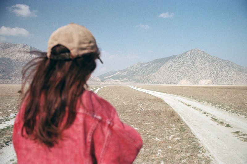 Road Filmisnotdead Film Photography Analogue Photography Real People One Person Rear View Lifestyles Women Day Road Standing Mountain Landscape Scenics - Nature Outdoors Nature