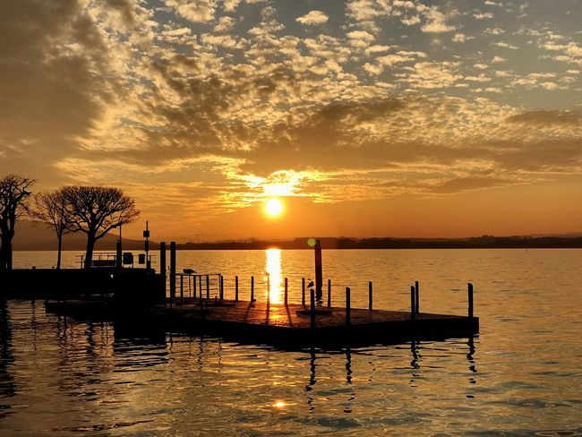 Sunset on a lake Sunset Water Sky Beauty In Nature Reflection Nature Outdoors Scenics Tranquil Scene Idyllic Cloud - Sky No People Tranquility Lake Outrigger Day