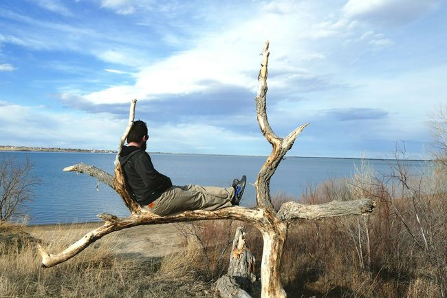 EyeEm Selects Gaze Sky Lake View Frame Tree Branches Seat Relaxing Pondering Nature Outdoors One Person Alone Time Comfortable Clouds And Sky Let's Go. Together. Lost In The Landscape
