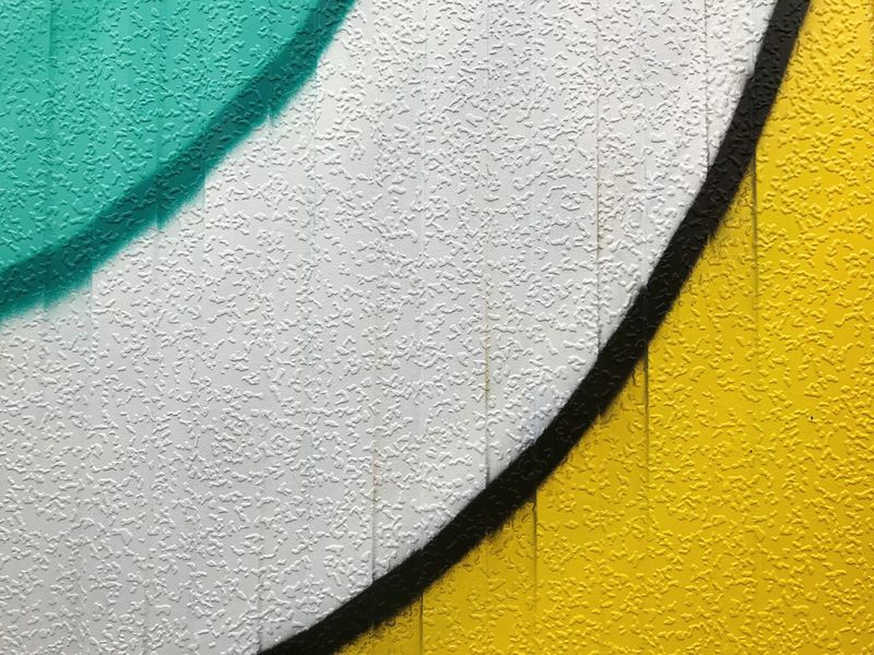 Painted wall with curves background Geometric Shape Curve Yellow Teal Graffiti No People Pattern Day Textured  High Angle View Backgrounds Yellow Wall - Building Feature Full Frame Outdoors Green Color Close-up Paint