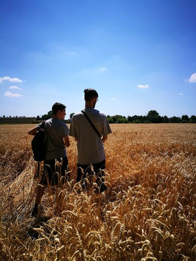 Brothers are special Big Brother And Little Brother  Family Walks Family Family Matters Special Relationship Brothers Walking Grain Field Men Togetherness Cereal Plant Agriculture Rear View Rural Scene Field Sky Combine Harvester Farmer Crop  Farmland Wheat Barley Cultivated Land Farm