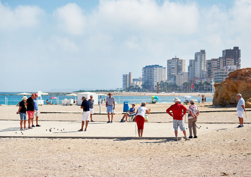 El Campello, Spain - May 22, 2018: Petanque players on the beach of El Campello. Petanque is a game where the goal is to toss hollow steel balls as close as possible to a small wooden ball. Alicante, Spain Alicante Alicante, Spain City Cityscape Coastline Costa Blanca El Campello Mediterranean Sea Pétanque Players SPAIN Beach Cloud - Sky Coast Day Game Group Of People Outdoors Pensioners Petanque Players Sand Sandy Beach Sea Seaside Tourist Resort