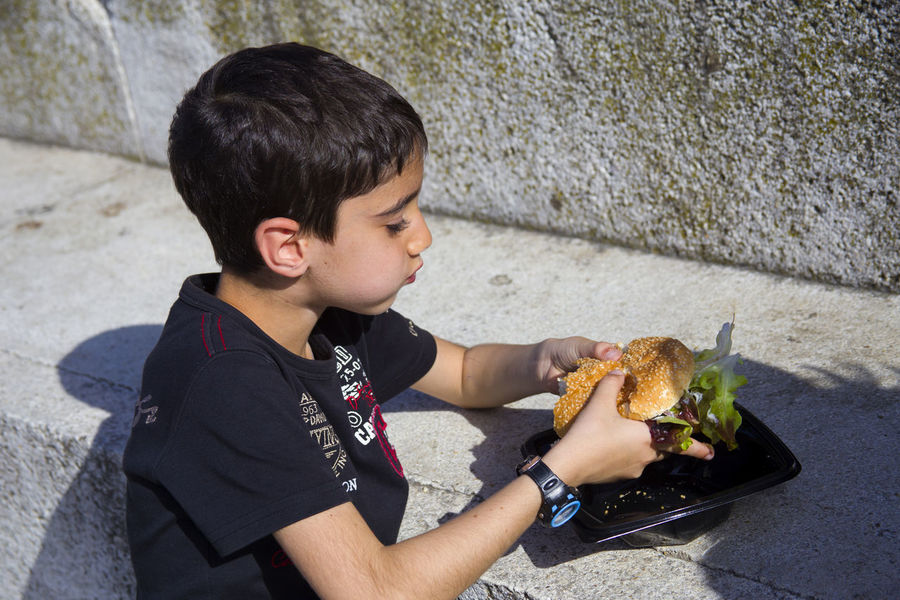 Appetite Boy Eat Eating Hungry Outdoors Sandwich Sandwich Time Sandwiches Show Us Your Takeaway! Takeaway Tasty Up Close Street Photography Telling Stories Differently The Street Photographer - 2016 EyeEm Awards Street Food Worldwide