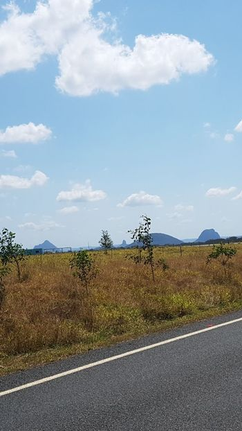 Cloud - Sky Road Sky Outdoors Day No People Landscape Nature Grass Beauty In Nature Glasshouse Mountains Australia Australian Landscape Taking Photos Taking Pictures Eyeem Photography EyeEm Nature Lover Travel Destinations Tranquility EyeEm Gallery Backgrounds Mountain Road Marking The Way Forward Transportation Tree Scenics