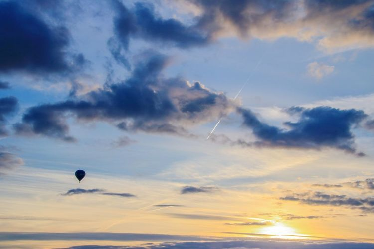 Hot Air Balloon Flying Transportation Sunset Cloud - Sky Travel Outdoors Mid-air Sky No People Landscape Nature Air Vehicle Vacations Adventure Scenics Day Aerospace Industry Breathing Space