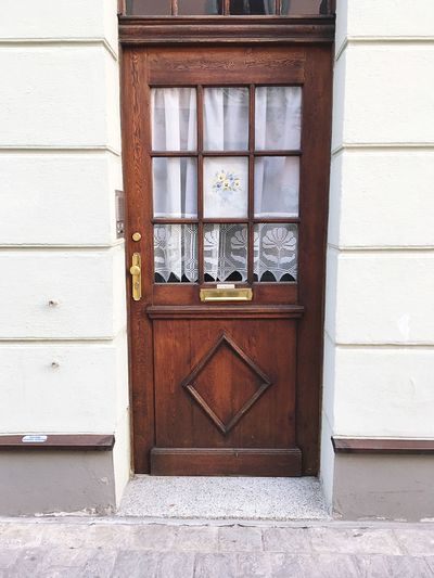 Doors in Bamberg #3 Doors Türen Bayern Flowers Bamberg  EyeEm Selects Built Structure Architecture Building Exterior Window Wall - Building Feature No People Day Building Closed Entrance Door Outdoors Wall Wood - Material Glass - Material Safety House Communication Protection Pattern