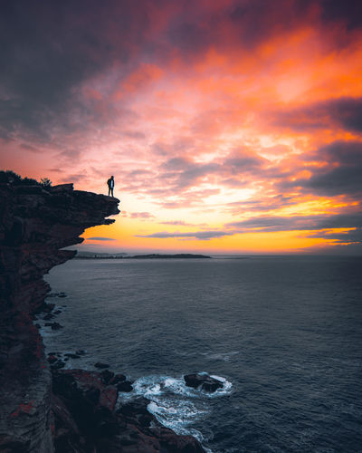 Feel the Fear: Do It Anyway EyeEmNewHere Lost In The Landscape View Beauty In Nature Cliff Cloud - Sky Day Horizon Over Water Nature Ocean One Person Orange Color Outdoors Rock - Object Scenics Sea Silhouette Sky Sunrise Sunset Tranquil Scene Tranquility Water