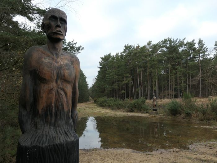 The right path EyeEm Selects Sculpture Statue Human Representation Tree Art And Craft Representation Plant Water Male Likeness Sky Nature Creativity Day No People Lake Reflection Architecture Craft Cloud - Sky Outdoors