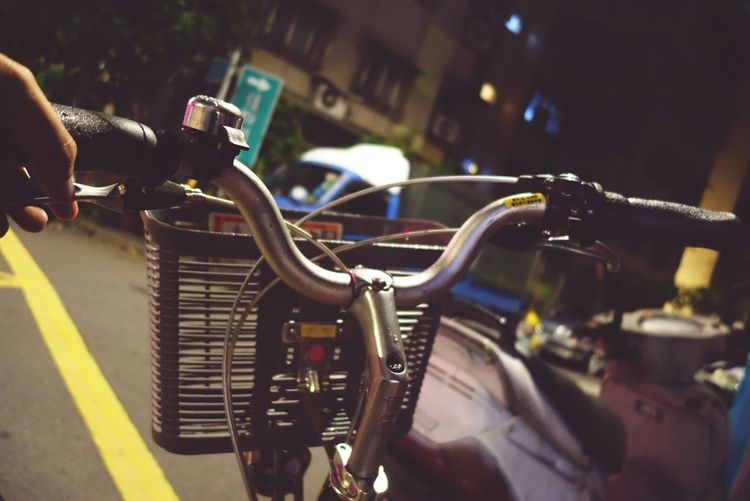 Focus On Foreground Real People Close-up Transportation Night City Handlebar Bicycle Outdoors Photography Themes Human Body Part Human Hand Street