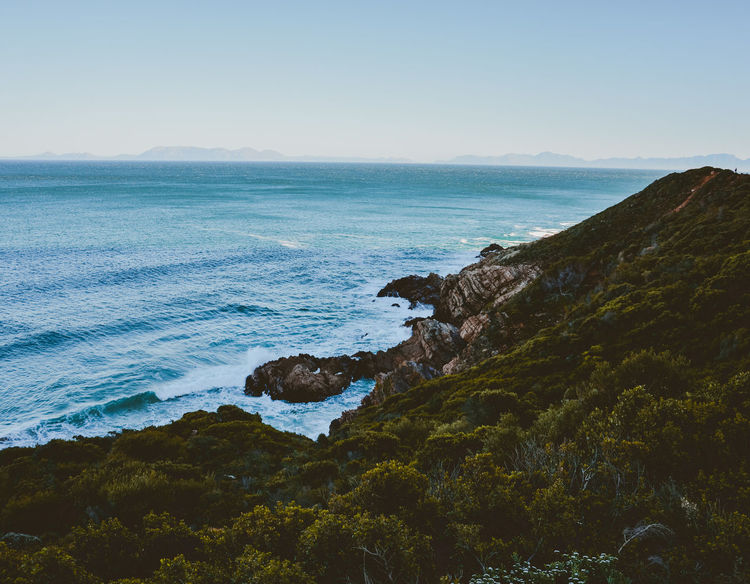 the rocky coastline of garden route, south africa. even tough the water are so pretty, i still cant belive we saw someone surfing there, the place is known to have sharks near the coast! crazy surfers... Blue Coast Coastline Nature Ocean Outdoors Rocky Scenics Sea Seascape Season  Surf Water