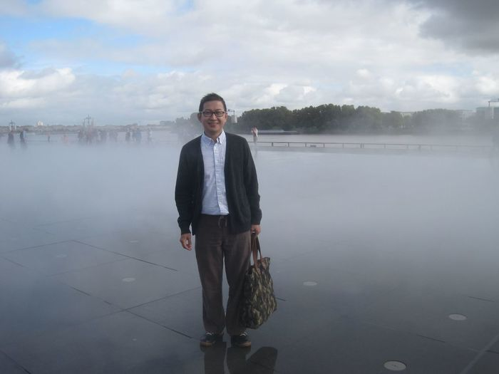 Portrait of man standing on tiled floor in fog