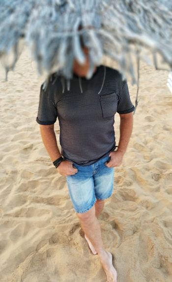 Beach Sand Human Back Standing Full Length Low Section Rear View Casual Clothing Rolled Up Pants Human Leg Human Foot Human Feet Legs Crossed At Ankle FootPrint barefoot Personal Perspective Shore Wearing