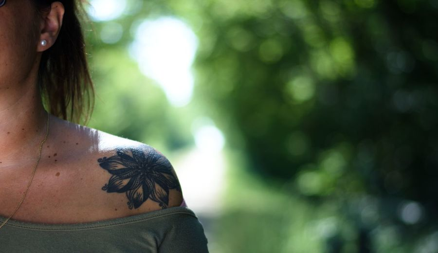 Close-up of woman with tattoo on shoulder
