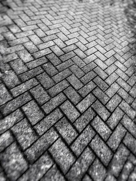 Warped floor. Brick Floor Stone Floor Zig Zag Herringbone Black And White Photography Lens Blur Tunnel Vision Blurry Vision Pavement Pavement Patterns Sidewalk Sidewalk Patterns Walkway Welcome To Black