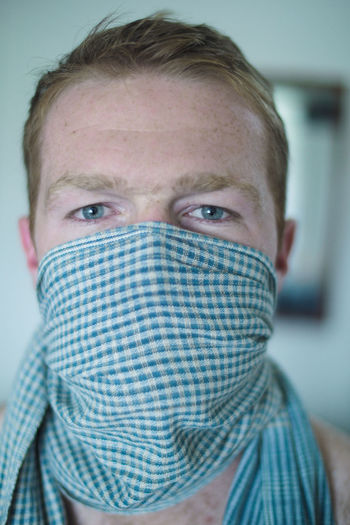 Close-Up Portrait Of Man Covering Face With Scarf