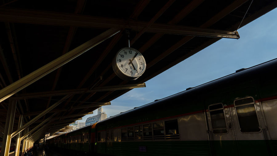 Low angle view of train at railroad station against sky