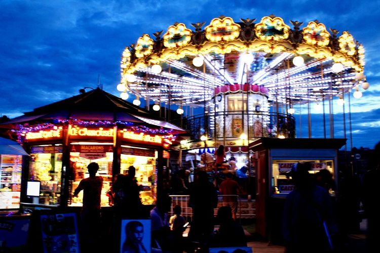 Nightlife in Paris Amusement Park Amusement Park Ride Arts Culture And Entertainment Leisure Activity Carousel Illuminated EyeEmNewHere Sky Night Incidental People Outdoors Motion People First Eyeem Photo
