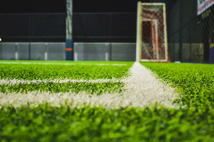 Goalkeeper Grass Sport Soccer Soccer Field Turf Green Color Playing Field Selective Focus Net - Sports Equipment Goal Stadium Team Sport Track And Field Stadium Night No People Outdoors Competition American Football Field Competitive Sport Close-up