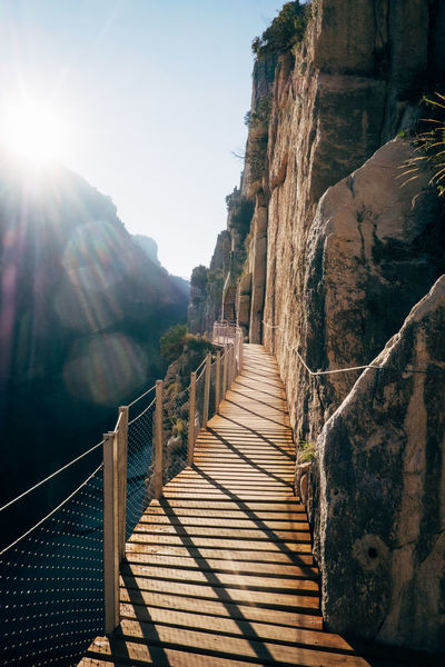 """The """"Caminito del Rey"""" was the most dangerous hiking trail in the world El Chorro Hiking Rock Beauty In Nature Caminito Del Rey Clear Sky Climbing Dangerous Day Hiking Trail Lens Flare Mountain Mountain Hiking Mountains Nature No People Outdoors Railing Rock Climbing Sky Steps Steps And Staircases Sunlight The Way Forward Tranquil Scene Tranquility"""