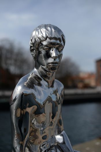 Close-up of statue against river