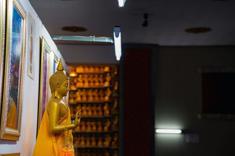 Close-up of illuminated sculpture in building