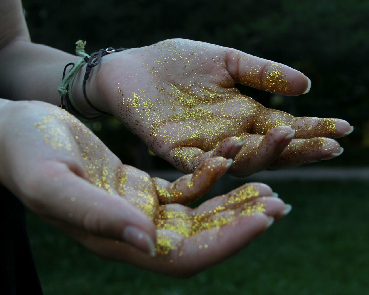 Cropped image of woman with glitter on hands