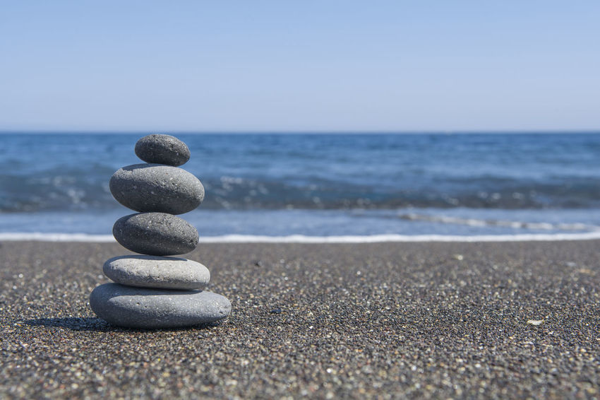 Balance stones on black beach Calm Life Meditation Relaxing Rock Yoga Arrangement Backgrounds Balance Beach Black Harmony Heap Leisure Activity Pebble Sand Sea Sky Spiritual Stability Stack Stone Tranquil Scene Tranquility Zen