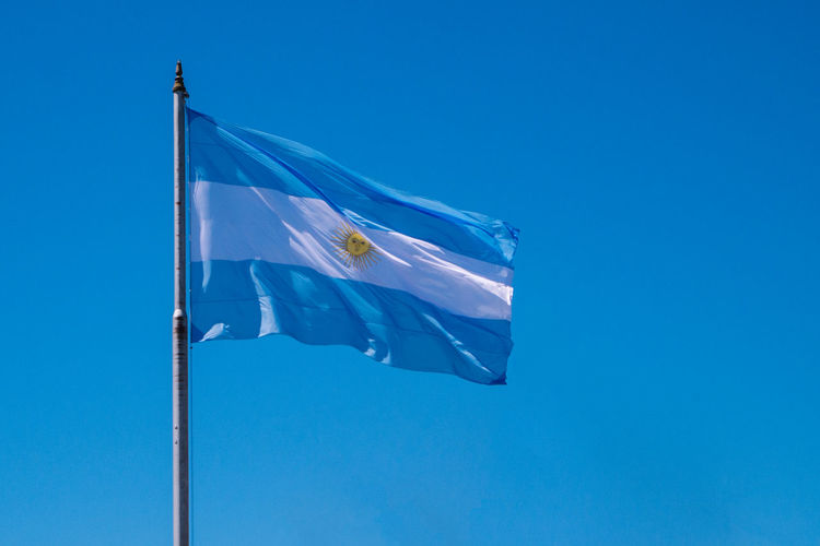 Argentina Blue Clear Sky Copy Space Day Flag Flag Pole Identity Low Angle View National Flag No People Outdoors Sky Tranquility Wind
