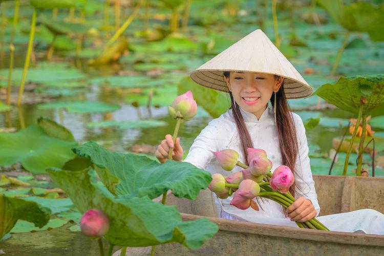 Portrait of girl holding plants
