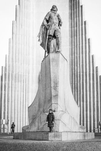 Statue of liberty against building
