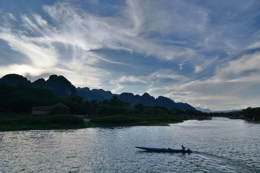 Pirogue on Nam river at dusk. Vang Vieng. Laos ASIA Beauty In Nature Boat Dusk Colours Laos Nam River Outdoors Pirogue River Riverscape Riverside Scenics Tranquility Travel Destinations Travel Photography Vang Vieng Vangvieng Vientiane Province