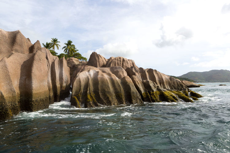 Water Rock Beauty In Nature Sky Sea Waterfront Scenics - Nature Nature Rock - Object Solid No People Rock Formation Motion Cloud - Sky Day Tranquility Tranquil Scene Land Non-urban Scene Outdoors Flowing Water St. Pierre Sey Seychelles Seychellesisland