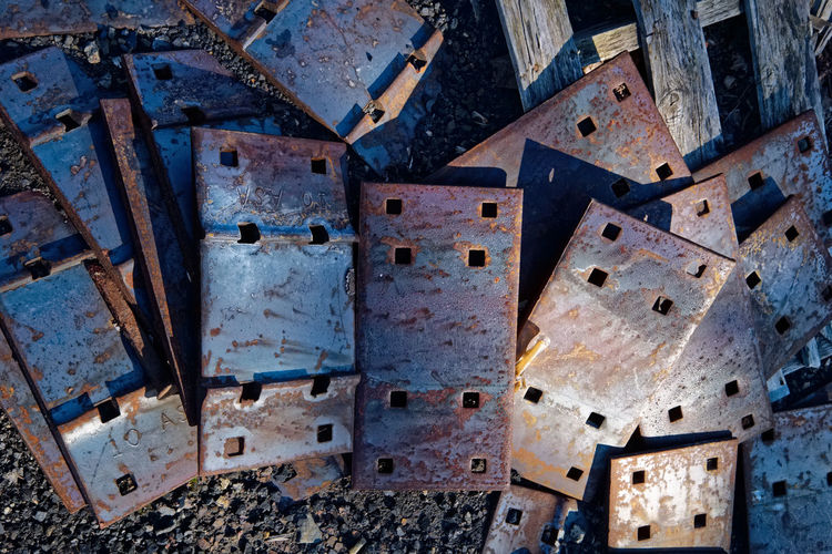 Railroad tie plates in the early morning light. Morning Light Abstract Close-up Early Morning Large Group Of Objects Metal No People Old Pattern Rusty Textured  Weathered Weathered Metal