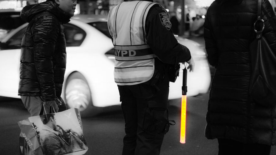 Light stick. NYPD Trafficcop Candid Photography NYC Photography People Watching Nightphotography Sony A6000 Project365 Lightroom