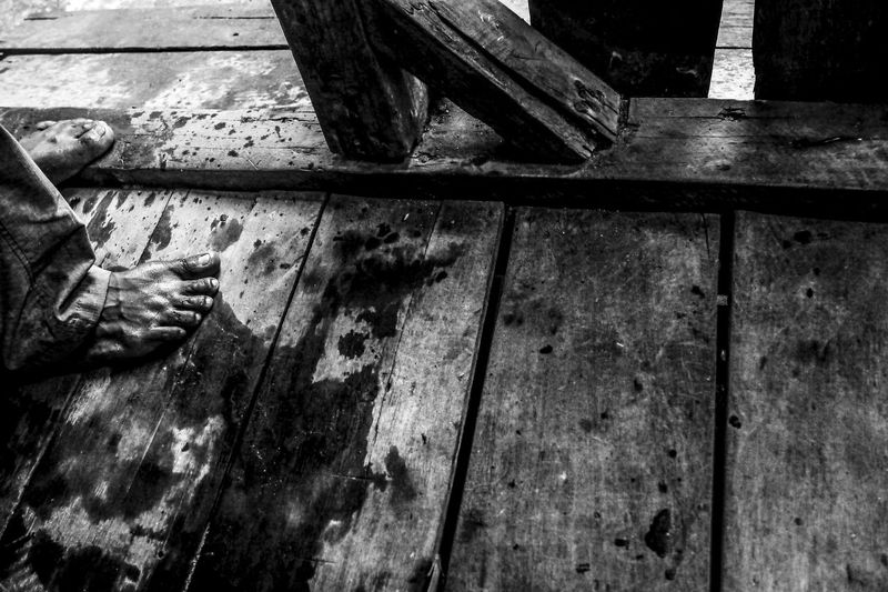 Low section of man on wooden floor