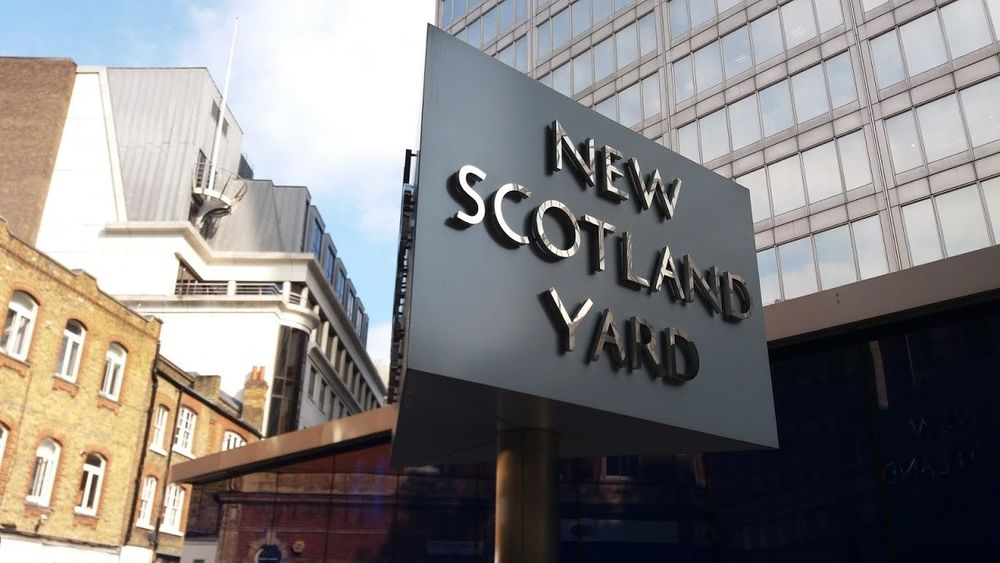 New Scotland Yard revolving sign Architecture Building Exterior Built Structure City Close-up Communication Day England London Low Angle View New Scotland Yard No People Outdoors Sign Signs Sky Text United Kingdom
