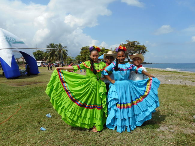 Honduras Adult Arts Culture And Entertainment Beach Cheerful Cultures Dancing Day Enjoyment Friendship Leisure Activity Men Nature Outdoors People Performance Portrait Real People Sky Smiling Standing
