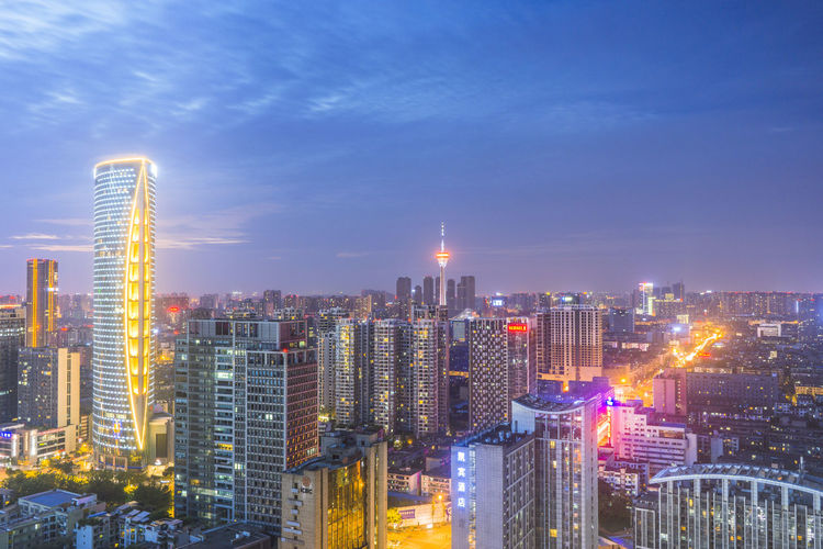 China 成都 Chengdu City Cityscape Urban Skyline Neon Illuminated Modern Skyscraper Downtown District Business Finance And Industry Sunset