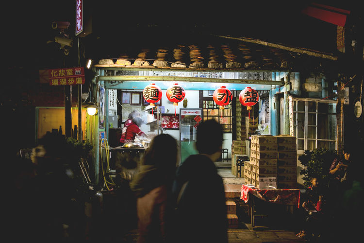 People in temple at night