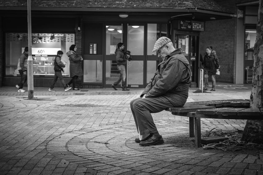 An old man waits patiently.... waiting ... waiting. Perhaps he wasn't old before he started waiting. Don't wait! Sitting Men Real People Full Length Street Group Of People People Bench City Seat Built Structure Architecture Lifestyles Casual Clothing Footpath Leisure Activity Side View Day Adult Outdoors Paving Stone Waiting Seated Cap Flat Cap